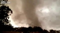 Thumbnail of Australian storm-chasers race away from tornado