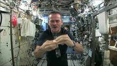 Thumbnail of Chris Hadfield demonstrates what happens when you ring out a washcloth in space