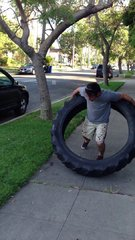 Thumbnail of Guy Hula Hoops 100 pound Tractor Tire