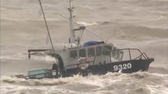 Thumbnail of Fishing boats in rough seas