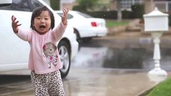 Thumbnail of Little girl experiences rain for the first time