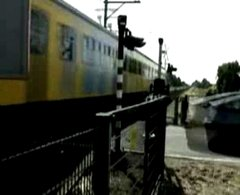 Thumbnail of Crazy driver nearly killed by train