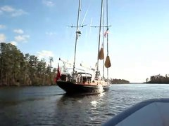 Thumbnail of Guy squeezes 80 foot tall sailboat under a 65 foot tall bridge