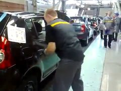 Thumbnail of A car door adjustment at Russian Renault factory