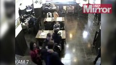 Thumbnail of Hungry man stays put, while masked gang storms restaurant