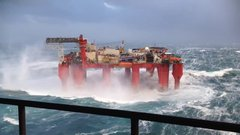 Thumbnail of Giant oil rig being thrown around by heavy seas