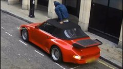 Thumbnail of A Really Inept Thief Tries To Steal A Porsche By Cutting A Hole In Its Roof
