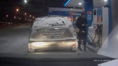 Thumbnail of Woman at the gas station