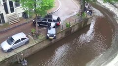 Thumbnail of Porsche Cayenne pushes Smart into Canals of Amsterdam
