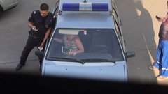 Thumbnail of Drunk Woman Breaks Police Car Windshield with Bare Feet