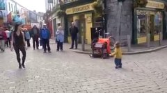 Thumbnail of Little lad joins a street performer in Galway, Ireland