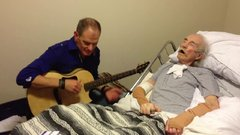 "Thumbnail of Mike Rayburn sings ""Cat's In The Cradle"" to his dying Dad"