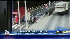 Thumbnail of Toddler walks away after stroller is hit by truck