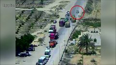 Thumbnail of Tank drives over suicide bomber's car before deadly blast