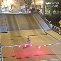 Thumbnail of Surveillance video shows bicyclist falling into Wisconsin draw bridge