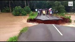 Thumbnail of Kerala road cave-in as flood water rushes in