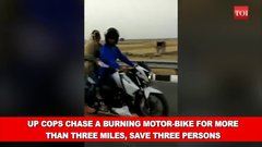 Thumbnail of India... UP cops chase a burning motor-bike for more than three miles, save three persons