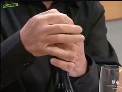 Thumbnail of Mexican guy demonstrating how to open a champagne bottle
