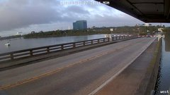 Thumbnail of Driver barrels through traffic arm to cross Daytona Beach drawbridge as it's going up