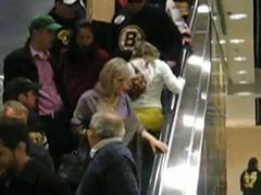 Thumbnail of Blonde climbing an escalator