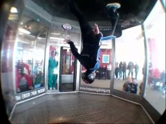 Thumbnail of Flying instructor gives demo at indoor skydiving