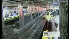 Thumbnail of Woman Falls in Front of Train