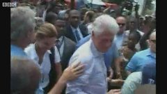 Thumbnail of Bush wipes hand on Clinton's shirt