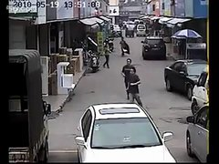 Thumbnail of Purse Snatchers on a Motorcycle Beaten by Angry Crowd