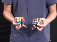 Thumbnail of Guy solves two Rubik's Cubes at once