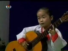 Thumbnail of Little North Korean girl amazing at guitar.