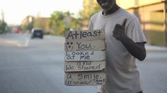 Thumbnail of Homeless man has the best sign
