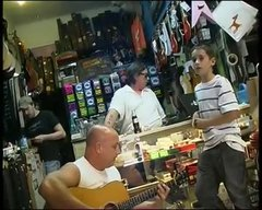 Thumbnail of Kid in Guitar Store