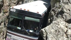 Thumbnail of Charter Bus in Rock Tunnel