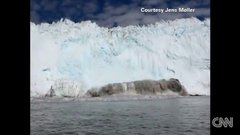 Thumbnail of Iceberg Avalanche Barrels Toward Boat