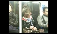 Thumbnail of Sleeping an the subway